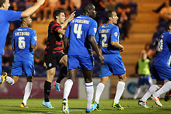 Peterborough United's Tommy Rowe scores the third goal  - Photo mandatory by-line: Joe Dent/JMP - Tel: Mobile: 07966 386802 06/08/2013 - SPORT - FOOTBALL - Weston Homes Community Stadium - Colchester -  Colchester United V Peterborough United - Capital One Cup - First Round