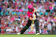 Sydney Sixers player Moises Henriques hits the ball at the Big Bash League cricket match between Sydney Sixers and Melbourne Stars at The Sydney Cricket Ground in Sydney, Australia