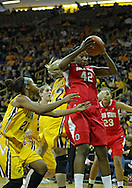 January 08 2010: Ohio St. center Jantel Lavender (42) pulls donw a rebound as Iowa guard Kachine Alexander (21) looks on during the first half of an NCAA womens college basketball game at Carver-Hawkeye Arena in Iowa City, Iowa on January 08, 2010. Iowa defeated Ohio State 89-76.