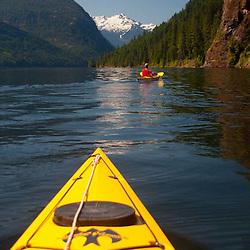 Joe Paddles Ahead on Ross Lake, Ross Lake National Recreation Area, North Cascades National Park, Washington, US