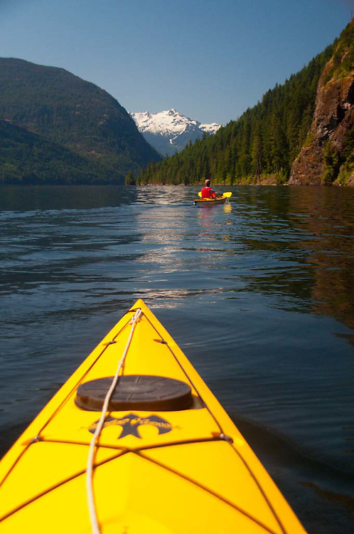 Joe Paddles Ahead on Ross Lake, Ross Lake National Recreation Area, North Cascades National Park, Washington, US