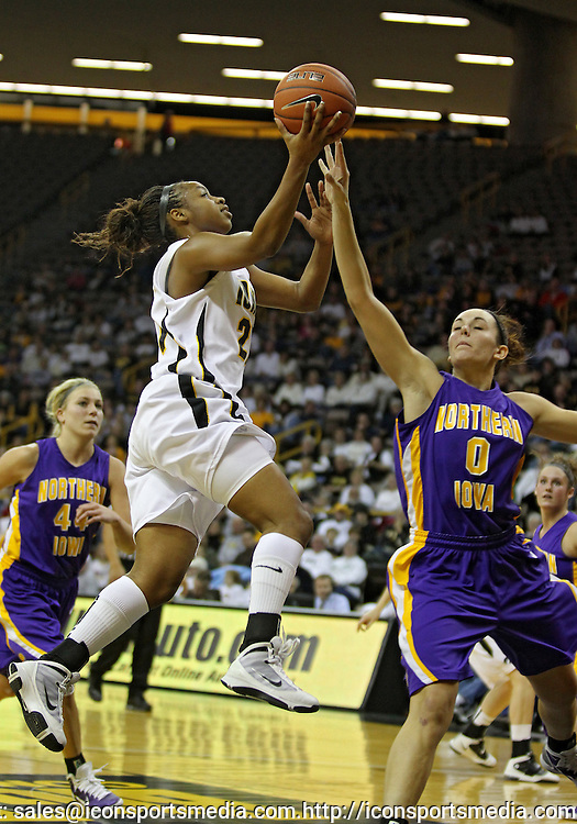 December 22 2010: Iowa guard Kachine Alexander (21) puts up a shot over Northern Iowa forward Amber Kirschbaum (0) during the first half of an NCAA college basketball game at Carver-Hawkeye Arena in Iowa City, Iowa on December 22, 2010. Iowa defeated Northern Iowa 75-64.