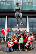 Sholing fans in front of the Bobby Moore statue outside Wembley Stadium before the FA Vase match at Wembley Stadium, London<br /> Picture by David Horn/Focus Images Ltd +44 7545 970036<br /> 10/05/2014
