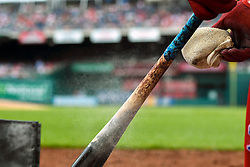 May 6, 2018 - Washington, DC, U.S. - WASHINGTON, DC - MAY 06:  Philadelphia Phillies second baseman Jesmuel Valentin (9) puts rosin on his bat during the game between the Philadelphia Phillies  and the Washington Nationals on May 6, 2018, at Nationals Park, in Washington D.C.  The Washington Nationals defeated the Philadelphia Phillies, 5-4.  (Photo by Mark Goldman/Icon Sportswire) (Credit Image: © Mark Goldman/Icon SMI via ZUMA Press)