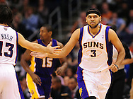 Feb. 19, 2012; Phoenix, AZ, USA; Phoenix Suns guard Jared Dudley (3) is high fived by teammate on the court while playing against the Los Angeles Lakers at the US Airways Center. Mandatory Credit: Jennifer Stewart-US PRESSWIRE..