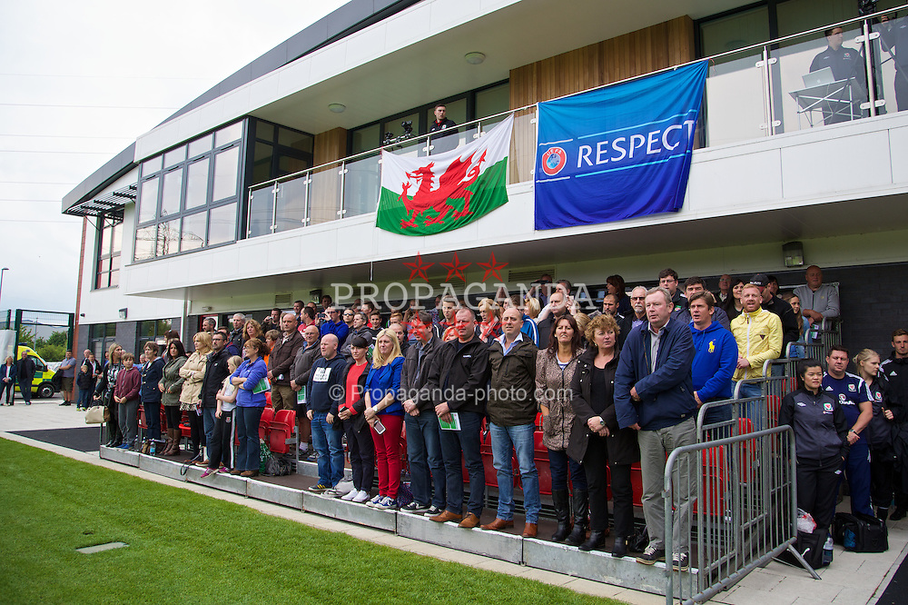 NEWPORT, WALES - Tuesday, May 27, 2014: Players' parents sing the national anthem during the Welsh Football Trust Cymru Cup 2014 at Dragon Park. (Pic by David Rawcliffe/Propaganda)
