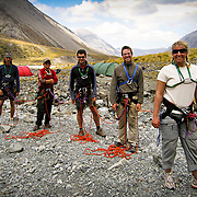 """Students pause for a photo before beginning a round of """"mountaineering olympics"""". The """"olympics"""" is a learning exercize in which students put their decision making and rope team skills to the test in the Arrowheads Mountain Range on the South Island, New Zealand, during  the mountaineering section of a semester course with the National Outdoor Leadership School.  Photo by Jen Klewitz © 2007"""