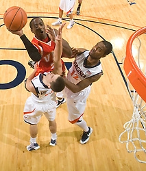 Virginia Military guard Travis Holmes (23) shoots over Virginia guard Sammy Zeglinski (13).  The Virginia Cavaliers defeated the Virginia Military Institute Keydets 107-97 in NCAA Basketball at the John Paul Jones Arena on the Grounds of the University of Virginia in Charlottesville, VA on November 16, 2008.
