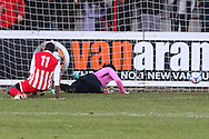 Goalkeeper Ashlee Jones of Lowestoft Town cannot prevent David Moyo of Brackley Town (left) scoring his team's second goal against Lowestoft Town to make it 2-0 during the Conference North match at St. James Park, Brackley<br /> Picture by David Horn/Focus Images Ltd +44 7545 970036<br /> 24/01/2015