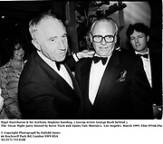 Nigel Hawthorne & Sir Anthony Hopkins bonding. ( Gossip writer George Rush behind ). at the  Oscar Night party hosted by Steve Tisch and Vanity Fair.. Morton's. Los Angeles. March 1995. 95548/29a<br />