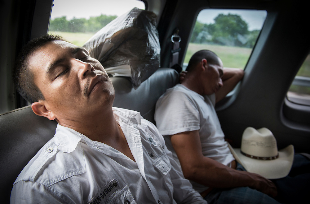 A 33-hour drive from Monterrey, Mexico, to Fountain Run, Kentucky, gets the best of Santiago Garcia, as the 14-passenger van drives through Texas. It acts as the last leg of a journey that lasts more than 70 hours on the road, a journey Santiago Garcia has made time and again. Nick Wagner / Alexia Foundation