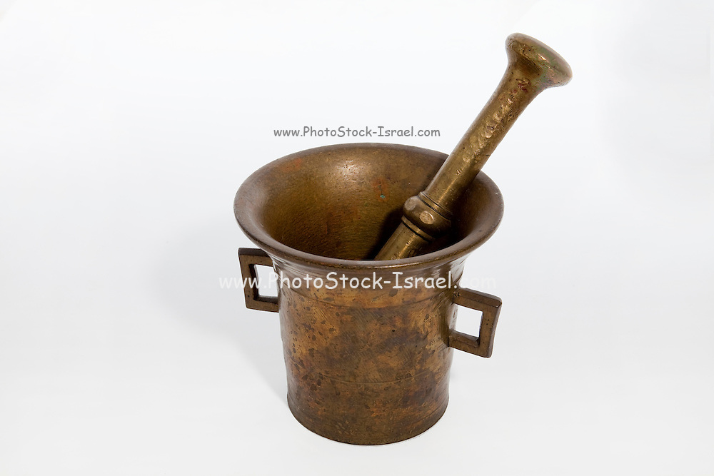Cutout of a pestle and mortar on white background