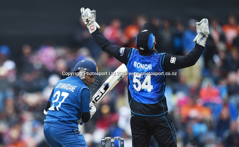 Luke Ronchi takes a catch to dismiss Jayawardene off the bowling of Vettori during the ICC Cricket World Cup match between New Zealand and Sri Lanka at Hagley Oval in Christchurch, New Zealand. Saturday 14 February 2015. Copyright Photo: Andrew Cornaga / www.Photosport.co.nz
