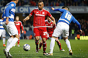 Middlesbrough FC midfielder Emilio Nsue (24) looks to take on Queens Park Rangers midfielder Alejandro Faurlín during the Sky Bet Championship match between Queens Park Rangers and Middlesbrough at the Loftus Road Stadium, London, England on 1 April 2016. Photo by Andy Walter.