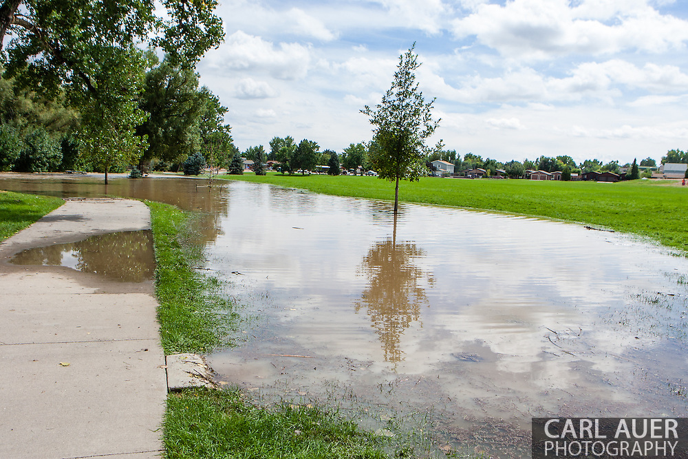 September 13, 2013: Ralston Creek overflows its banks and floods the Ralston Creek Trail bike path and picnic areas off of Oak Street in Arvada after record breaking rains hit Colorado over the last few days
