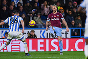 Marko Arnautovic of West Ham United (7) lifts the ball past Christopher Schindler of Huddersfield Town (26) during the Premier League match between Huddersfield Town and West Ham United at the John Smiths Stadium, Huddersfield, England on 10 November 2018.