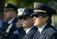 Jeryl Degideo (cq) (right) of Ivyland, Pennsylvania, along with other emergency medical personnel listen as names of Bucks County victims are read during a 9/11 ceremony at the Global War on Terrorism Memorial Monday September 11, 2017 at old Bucks County Courthouse in Doylestown, Pennsylvania. (Photo by William Thomas Cain)