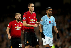 """Manchester United's Nemanja Matic (left) and Manchester City's Riyad Mahrez (right) during the Premier League match at the Etihad Stadium, Manchester. PRESS ASSOCIATION Photo. Picture date: Sunday November 11, 2018. See PA story SOCCER Man City. Photo credit should read: Nick Potts/PA Wire. RESTRICTIONS: EDITORIAL USE ONLY No use with unauthorised audio, video, data, fixture lists, club/league logos or """"live"""" services. Online in-match use limited to 120 images, no video emulation. No use in betting, games or single club/league/player publications."""