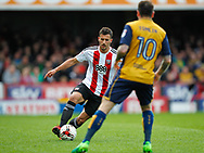 Maxime Colin of Brentford and Lee Tomlin of Bristol City during the Sky Bet Championship match between Brentford and Bristol City at Griffin Park, London<br /> Picture by Mark D Fuller/Focus Images Ltd +44 7774 216216<br /> 01/04/2017