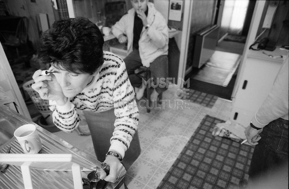 Josephine doing her make-up by the sink, UK, 1980s.