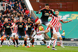Chris Smalling of Manchester United is challenged by Geoff Cameron of Stoke City - Mandatory byline: Rogan Thomson/JMP - 26/12/2015 - FOOTBALL - Britannia Stadium - Stoke, England - Stoke City v Manchester United - Barclays Premier League - Boxing Day Fixture.