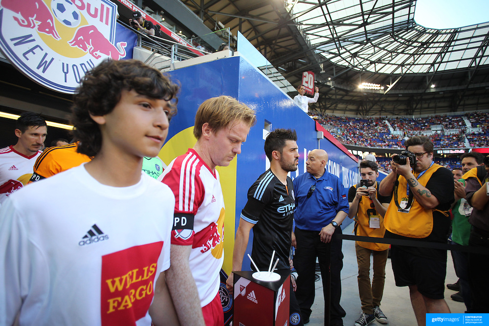 Dax McCarty, (left), New York Red Bulls and David Villa, NYVFC, lead their teams out during the New York Red Bulls Vs NYCFC, MLS regular season match at Red Bull Arena, Harrison, New Jersey. USA. 10th May 2015. Photo Tim Clayton