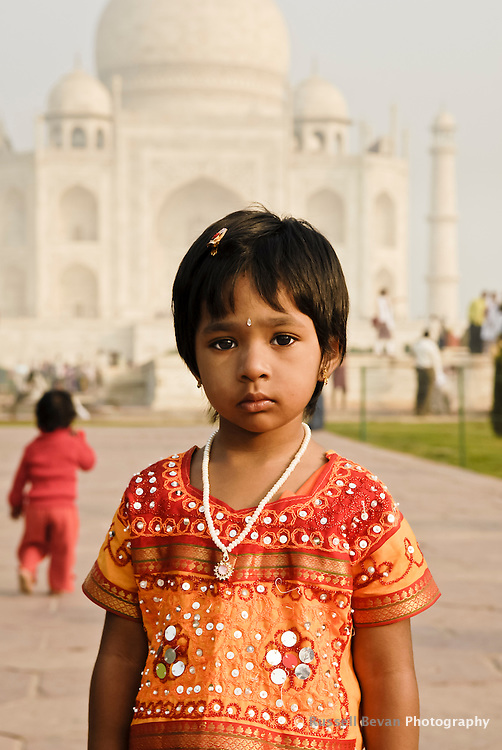A portrait of a small indian girl at the Taj Mahal in Agra, Uttar Pradesh, India