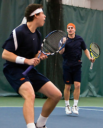 Virginia's Drew Courtney (front} and Lee Singer (back) celebrate their victory over Virginia Tech's Brandon Corace and Pedro Graber in the #3 doubles match.  The #1 ranked Virginia Cavaliers faced the #31 ranked Virginia Tech Hokies in NCAA Men's Tennis at the Boar's Head Sports Club in Charlottesville, VA on February 27, 2009.