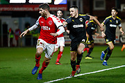 Fleetwood Town forward Ched Evans (9) on loan from Sheffield United,  is watched closely by Wimbledon midfielder Anthony Hartigan (8)  during the The FA Cup 3rd round match between Fleetwood Town and AFC Wimbledon at the Highbury Stadium, Fleetwood, England on 5 January 2019.