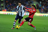 West Brom's Morgan Amalfitano is tackled by Cardiff's Gary Medel. Barclays Premier league, Cardiff city v West Bromwich Albion at the Cardiff city Stadium in Cardiff, South Wales on Saturday 14th Dec 2013. pic by Andrew Orchard, Andrew Orchard sports photography.