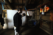 Master sake brewer Philip Harper from the United Kingdom prays before a portable shrine prior to the first batch of sake rice wine at the Tamagawa Sake Brewery in Kyoto, Japan. More than 1,200 sake breweries exist in Japan, though falling domestic consumption has lead some to look to  overseas markets. Photographer: Robert Gilhooly