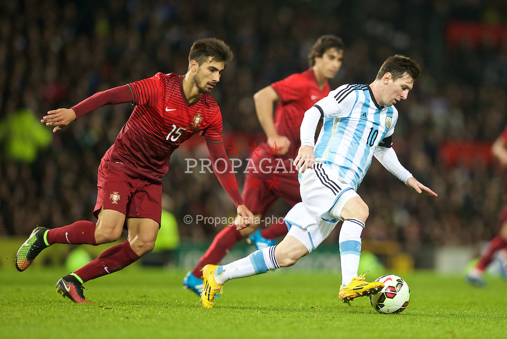 MANCHESTER, ENGLAND - Tuesday, November 18, 2014: Argentina's captain Lionel Messi in action against Portugal's Andre Gomes during the International Friendly match at Old Trafford. (Pic by David Rawcliffe/Propaganda)