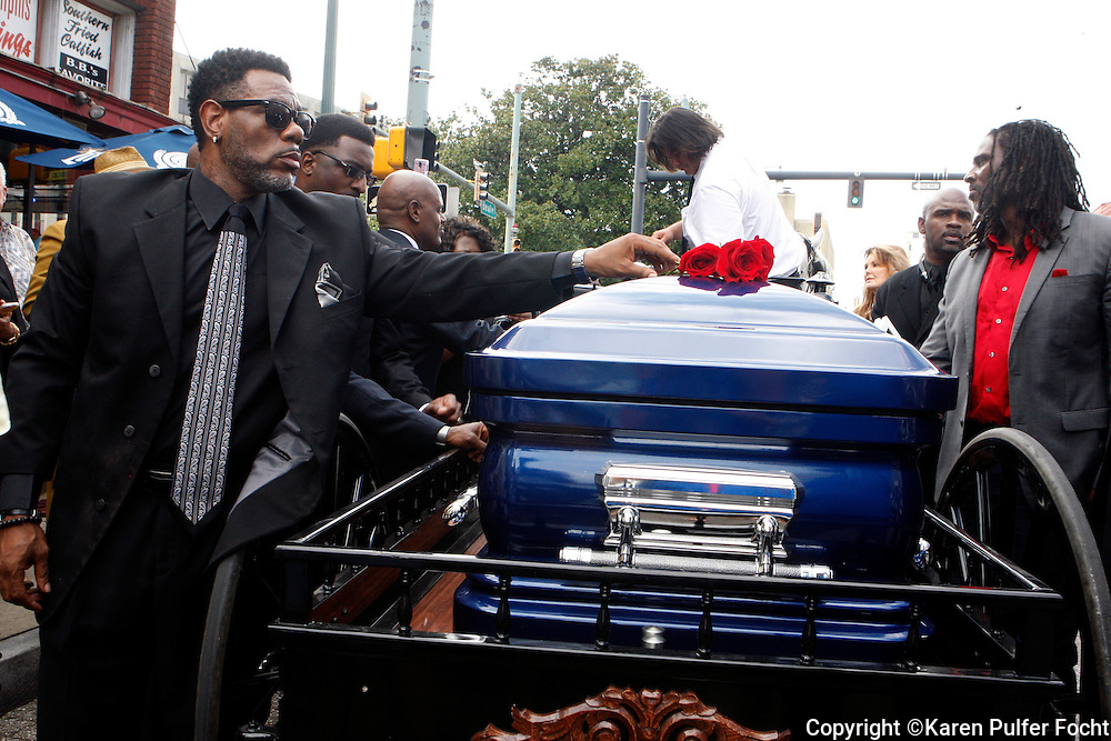 A New Orleans-style brass band funeral and procession for R&B singer Ruby Wilson was held on Beale Street in Memphis  Friday afternoon. The procession came to rest outside of B.B. King's Club where she often played. Tearful family and friends  gathered at the club. Wilson died last week after being hospitalized following a heart attack. She was 68. She had a blue casket.