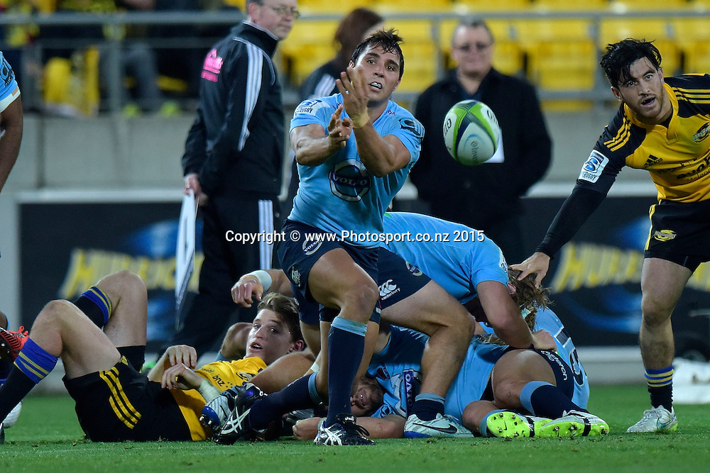 Waratahs' Bernard Foley makes a pass during the Super Rugby - Hurricanes v Waratahs rugby union match at the Westpac Stadium in Wellington on Saturday the 18th of April 2015. Photo by Marty Melville / www.Photosport.co.nz