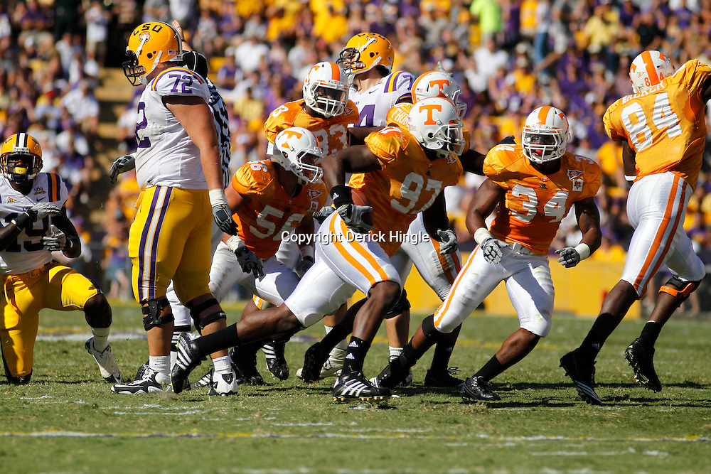 Oct 2, 2010; Baton Rouge, LA, USA; Tennessee Volunteers defensive end Malik Jackson (97) celebrates after recovering a fumble against the LSU Tigers during the first half at Tiger Stadium.  Mandatory Credit: Derick E. Hingle