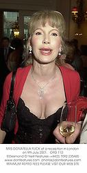 MRS DONATELLA FLICK at a reception in London on 9th July 2001.<br />