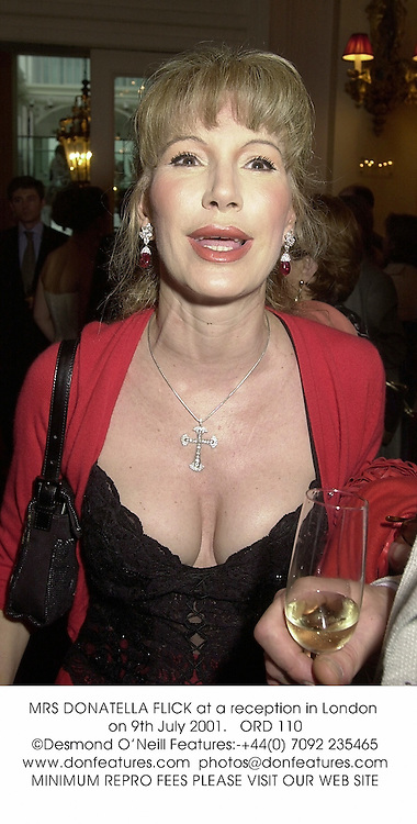 MRS DONATELLA FLICK at a reception in London on 9th July 2001.<br />ORD 110