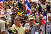 "09 DECEMBER 2013 - BANGKOK, THAILAND: Thai anti-government protestors gather in front of Government House in Bangkok. Thai Prime Minister Yingluck Shinawatra announced she would dissolve the lower house of the Parliament and call new elections in the face of ongoing anti-government protests in Bangkok. Hundreds of thousands of people flocked to Government House, the office of the Prime Minister, Monday to celebrate the collapse of the government after Yingluck made her announcement. Former Deputy Prime Minister Suthep Thaugsuban, the organizer of the protests, said the protests would continue until the ""Thaksin influence is uprooted from Thailand."" There were no reports of violence in the protests Monday.      PHOTO BY JACK KURTZ"