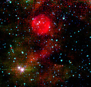 Massive stars typically end their lives in explosive cataclysms, or supernovae, flinging abundant amounts of hot gas and radiation into outer space. Thirty thousand light-years away in the Cepheus constellation, astronomers think they've found a massive star whose death barely made a peep. Remnants of this shy star's supernova would have gone completely unnoticed if the super-sensitive eyes of NASA's Spitzer Space Telescope hadn't accidentally stumbled upon it. These three panels (figure 1) illustrate just how shy this star is. Unlike most supernova remnants, which are detectable at a variety of wavelengths ranging from radio to X-rays, this source only shows up in mid-infrared images taken by Spitzer's multiband imaging photometer. The remnant can be seen as a red-orange blob at the centre of the picture (figure 4).Although the visible-light (figure 2) and near-infrared (figure 3) images capture the exact same region of space, the source is completely invisible in both pictures. Astronomers suspect that the remnant's elusiveness is due to its location, away from our Milky Way galaxy's dusty main disk, which contains most of the galaxy's stars. A supernova is most noticeable when the material expelled during the star's furious death throes violently collides with surrounding dust. Since the shy star sits away from the galaxy's dusty and crowded disk, the hot gas and radiation it flung into space had little surrounding material to crash into. Thus, it is largely invisible at most wavelengths.