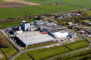 Nederland, Friesland, Gemeente Sudwest-Fryslan (Zuidwest-Friesland), 16-04-2012. Workum met Frico kaasfabriek (onderdeel van Friesland Campina)..Cheese factory in Frisian countryside..luchtfoto (toeslag), aerial photo (additional fee required);.copyright foto/photo Siebe Swart