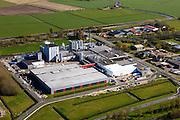 Nederland, Friesland, Gemeente Sudwest-Fryslan (Zuidwest-Friesland), 16-04-2012. Workum met Frico kaasfabriek (onderdeel van Friesland Campina)..Cheese factory in Frisian countryside..luchtfoto (toeslag), aerial photo (additional fee required);.copyright foto/photo Siebe Swart
