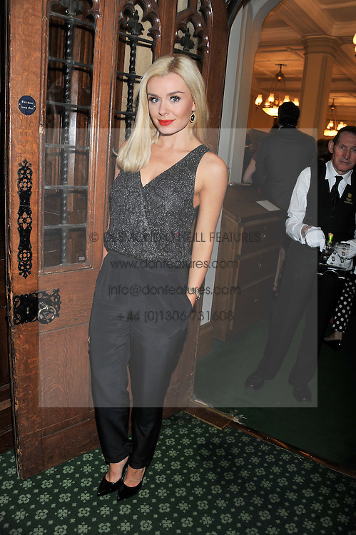 KATHERINE JENKINS at a reception for The Mirela Fund in partnership with Hope and Homes for Children hosted by Natalie Pinkham in The Churchill Room, House of Commons, London on 30th April 2013.
