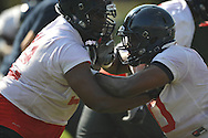 Ole Miss' Carlton Martin (92) and Kentrell Lockett (40) go through a drill at  football practice in Oxford, Miss. on Sunday, August 7, 2011.