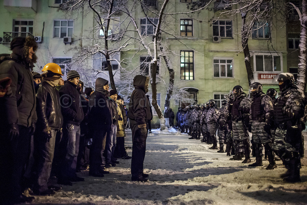 Silent face off between protesters and anti riot Berkut units on a street near the Presidential compound, on December 9, 2013 in Kiev, Ukraine. Thousands of protesters have taken to the streets since Ukrainian president Viktor Yanukovych announced a decision to suspend a trade and partnership agreement with the European Union and raised concerns that the nation could be poised to returned with Russia's orbit. 09 December 2013.