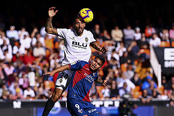 December 23, 2018 - Valencia, Spain - Ezequiel Garay of Valencia CF (L) and Hernandez  of SD Huesca during  spanish La Liga match between Valencia CF vs SD Hueca at Mestalla Stadium on December 23, 2018. (Photo by Jose Miguel Fernandez/NurPhoto) (Credit Image: © Jose Miguel Fernandez/NurPhoto via ZUMA Press)