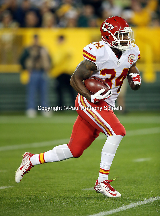 Kansas City Chiefs running back Knile Davis (34) returns a first quarter kick 54 yards to Green Bay Packers territory during the 2015 NFL week 3 regular season football game against the Green Bay Packers on Monday, Sept. 28, 2015 in Green Bay, Wis. The Packers won the game 38-28. (©Paul Anthony Spinelli)