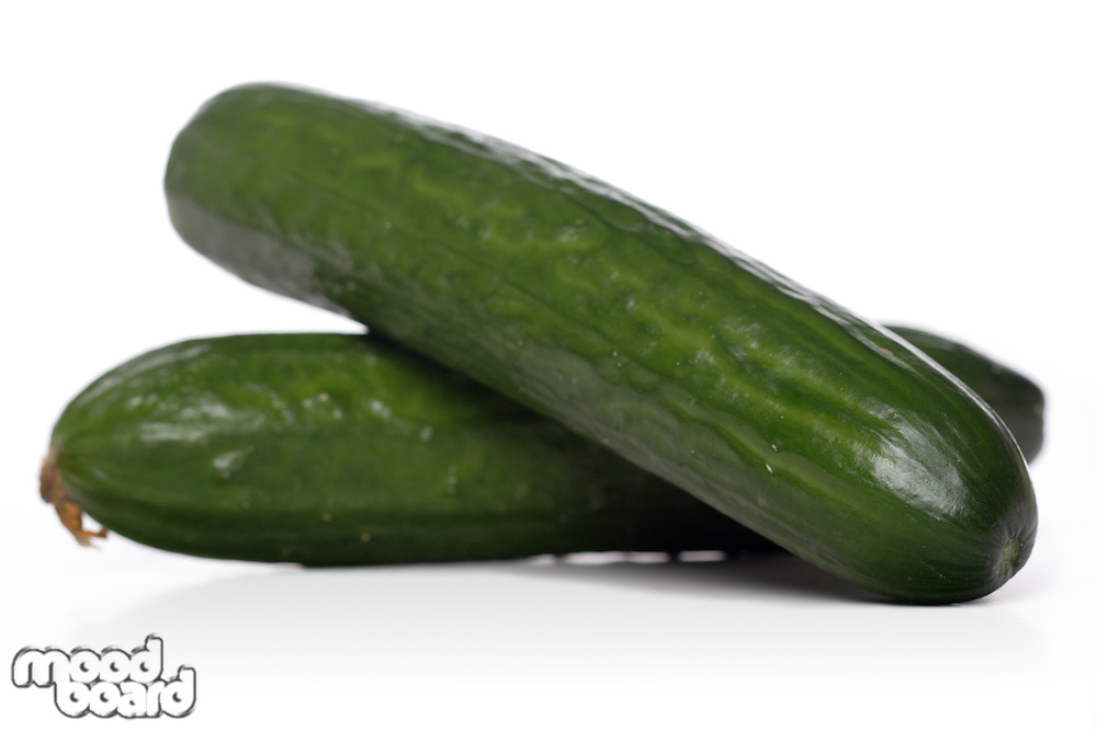 Close up of cucumbers on white background
