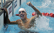 Scotland's David Carry celebrates after winning gold in the mens 400m freestyle final during the swimming at the Melbourne Sports & Aquatic Centre on day one of the XVIII Commonwealth Games, Melbourne, Australia, Thursday, March 16 2006. Photo: Michael Bradley/PHOTOSPORT<br /><br /><br /><br />149774