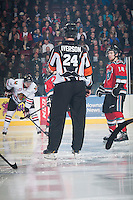 KELOWNA, CANADA - NOVEMBER 21: Referee Brett Iverson stands at centre ice between the Kelowna Rockets and the Portland Winterhawks on November 21, 2014 at Prospera Place in Kelowna, British Columbia, Canada.  (Photo by Marissa Baecker/Shoot the Breeze)  *** Local Caption *** Brett Iverson;