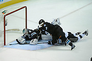 May 26, 2013; San Jose, CA, USA; San Jose Sharks goalie Antti Niemi (31) makes a stick save against Los Angeles Kings left wing Kyle Clifford (13) during the second period in game six of the second round of the 2013 Stanley Cup Playoffs at HP Pavilion.